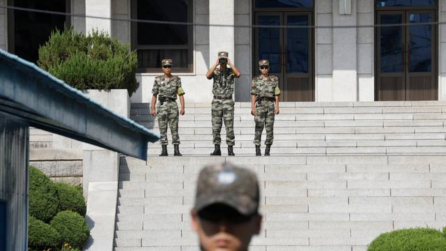 North Korean soldiers patrol in the truce village of Panmunjom
