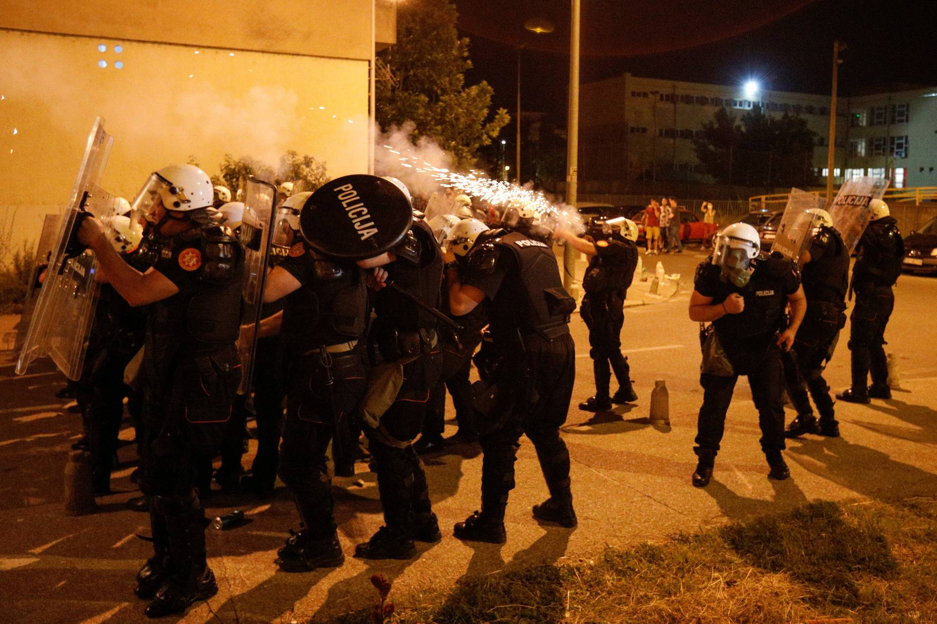 Riot police fire tear gas in front of police station in Podgorica