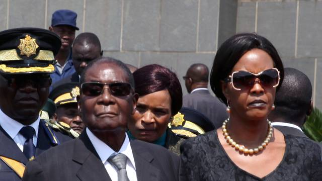 Mugabe and his wife Grace arrive for the burial of two independence luminaries in Harare