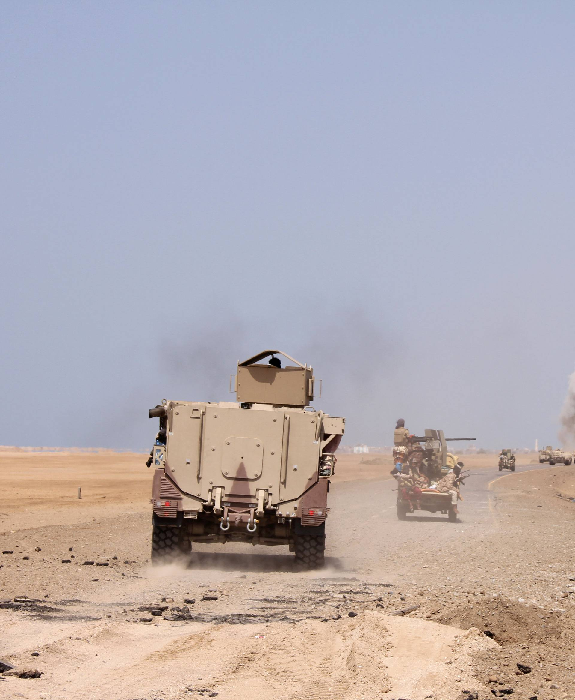 Smoke rises as a Yemeni military armoured personnel carrier was hit by a Houthi rocket near the Red Sea coast city of al-Mokha