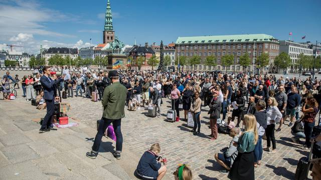 Members of the Danish airline industry demonstrate in favor of opening the country's boarders more in front of the Parliament building Christiansborg, in Copenhagen
