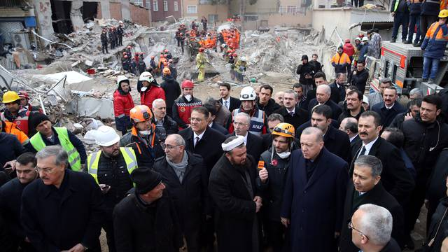 Turkish President Erdogan visits the site of a collapsed residential building in Istanbul