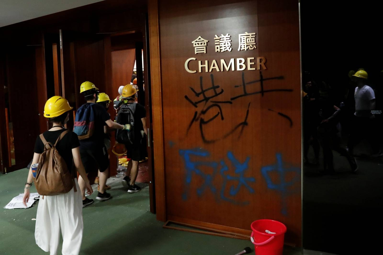 Graffiti left by anti-extradition bill protesters as they break into the Legislative Council building during the anniversary of Hong Kong's handover to China in Hong Kong
