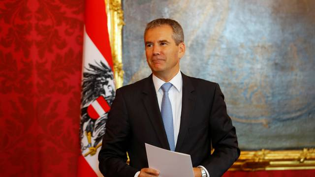 Hartwig Loeger reacts after being sworn in as Austria's provisional chancellor by Austrian President Alexander Van der Bellen, after a no-confidence vote by the Parliament in Vienna