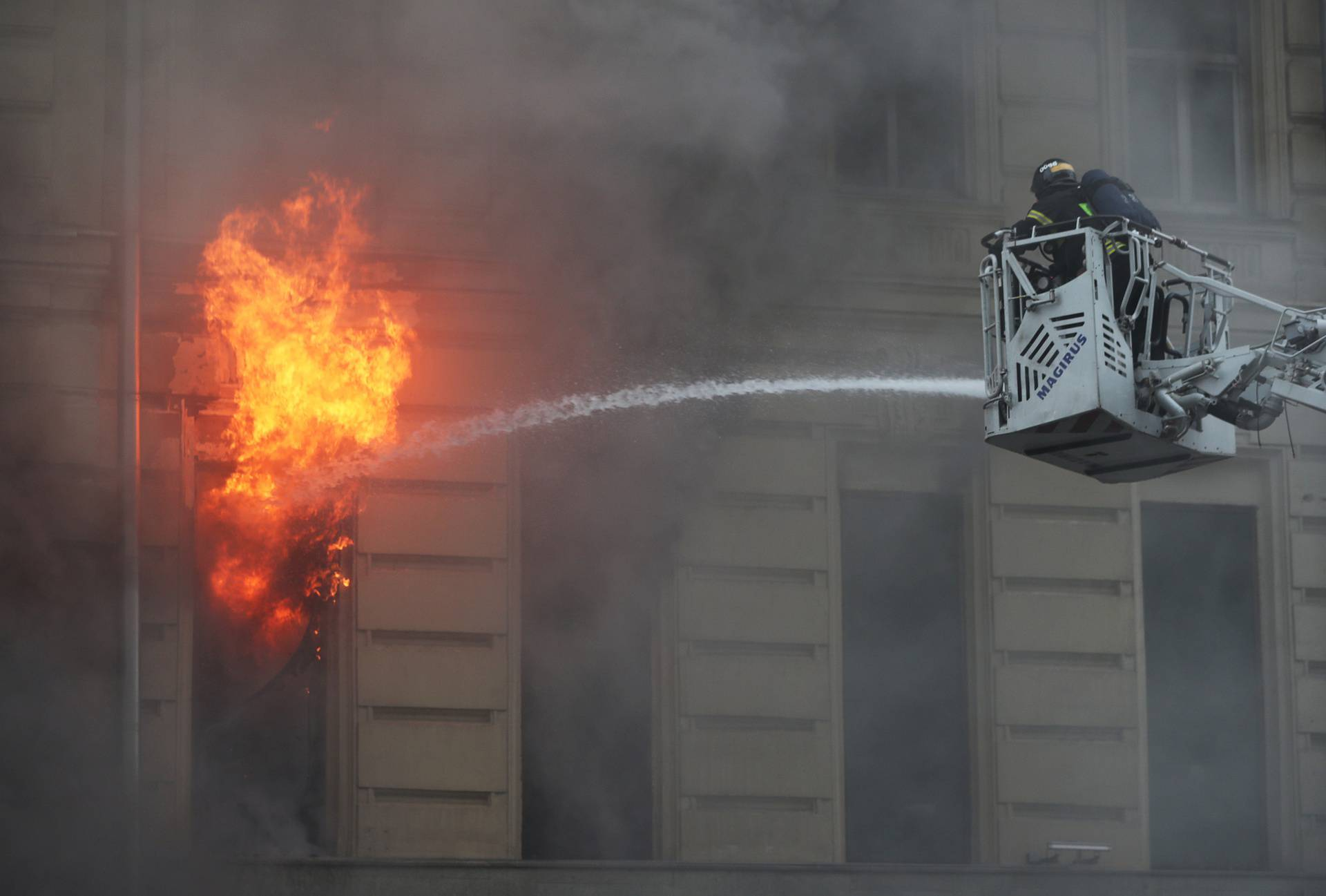 Firefighters work to extinguish a fire at a building in central Moscow