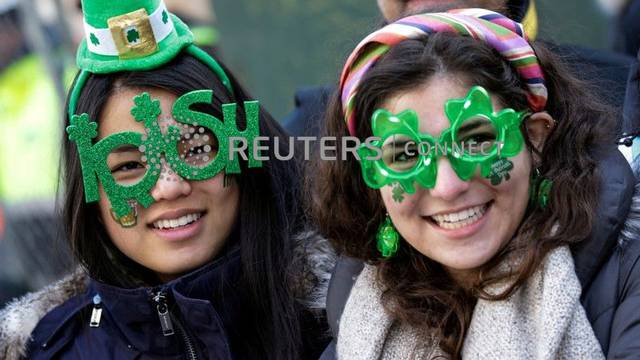 FILE PHOTO: Paradegoers watch the St Patrick's Day parade in New York City