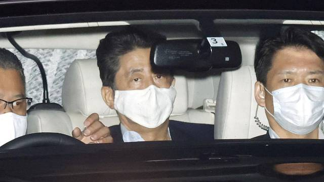 Japanese Prime Minister Shinzo Abe arrives at his residence as he returns from Keio University Hospital in Tokyo