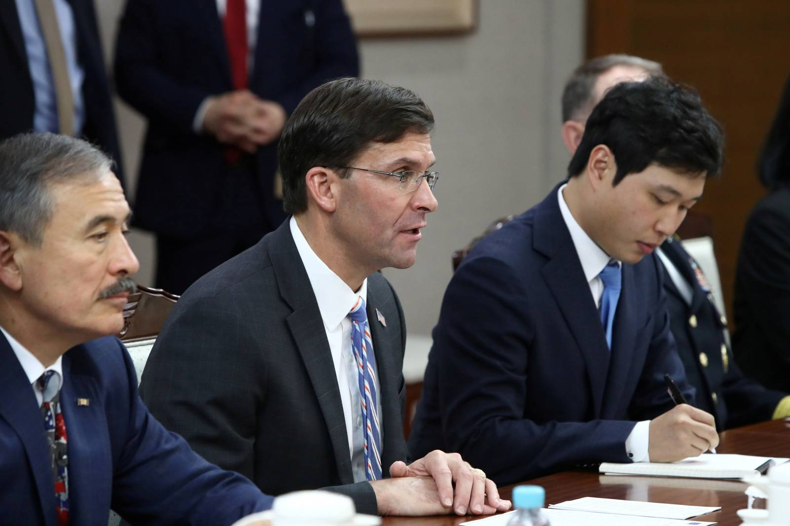 U.S. Defense Secretary Mark Esper talks to South Korean Defense Minister Jeong Kyeong-doo during their meeting in Seoul