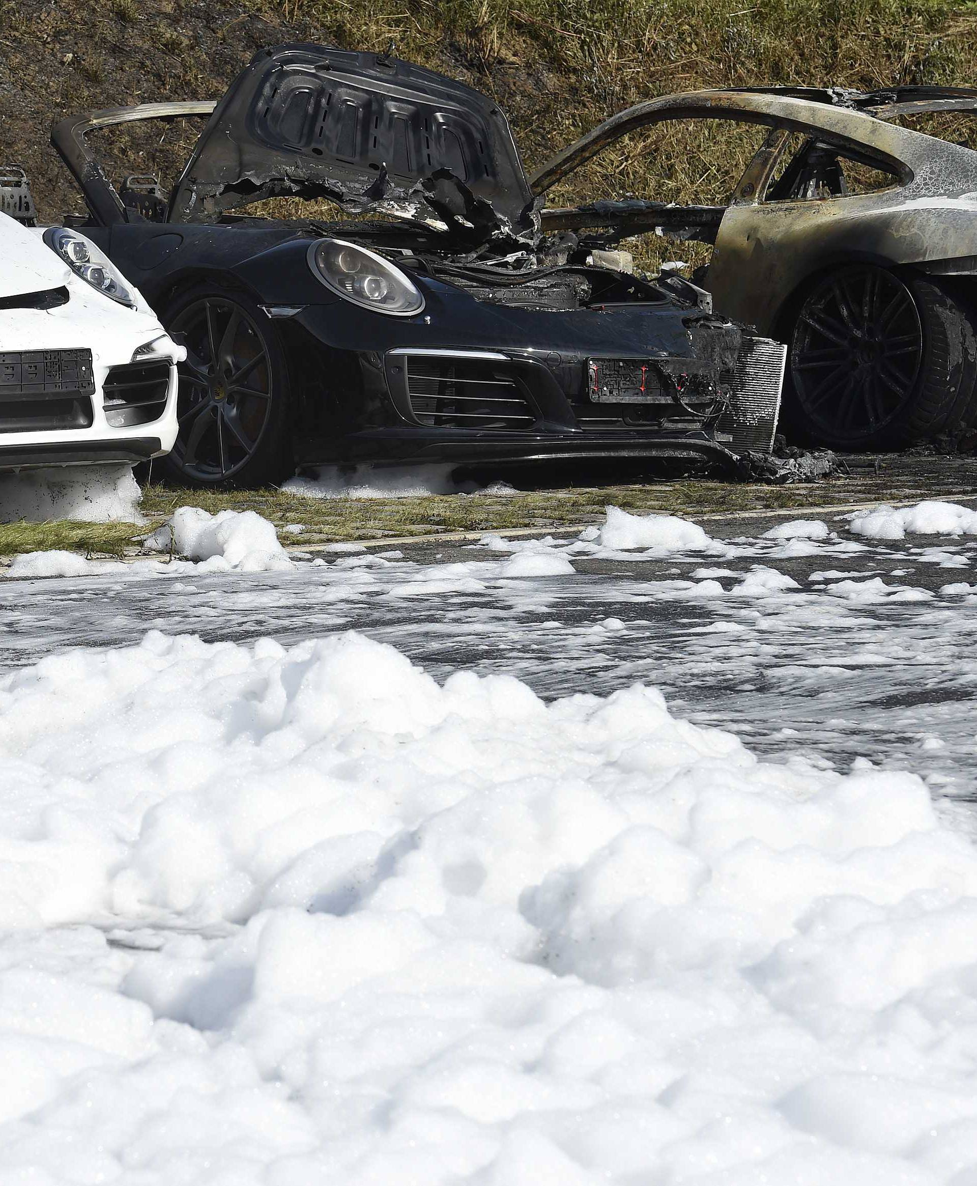 Burnt cars are seen at a Porsche showroom where a fire broke overnight ahead of the G20 summit in Hamburg