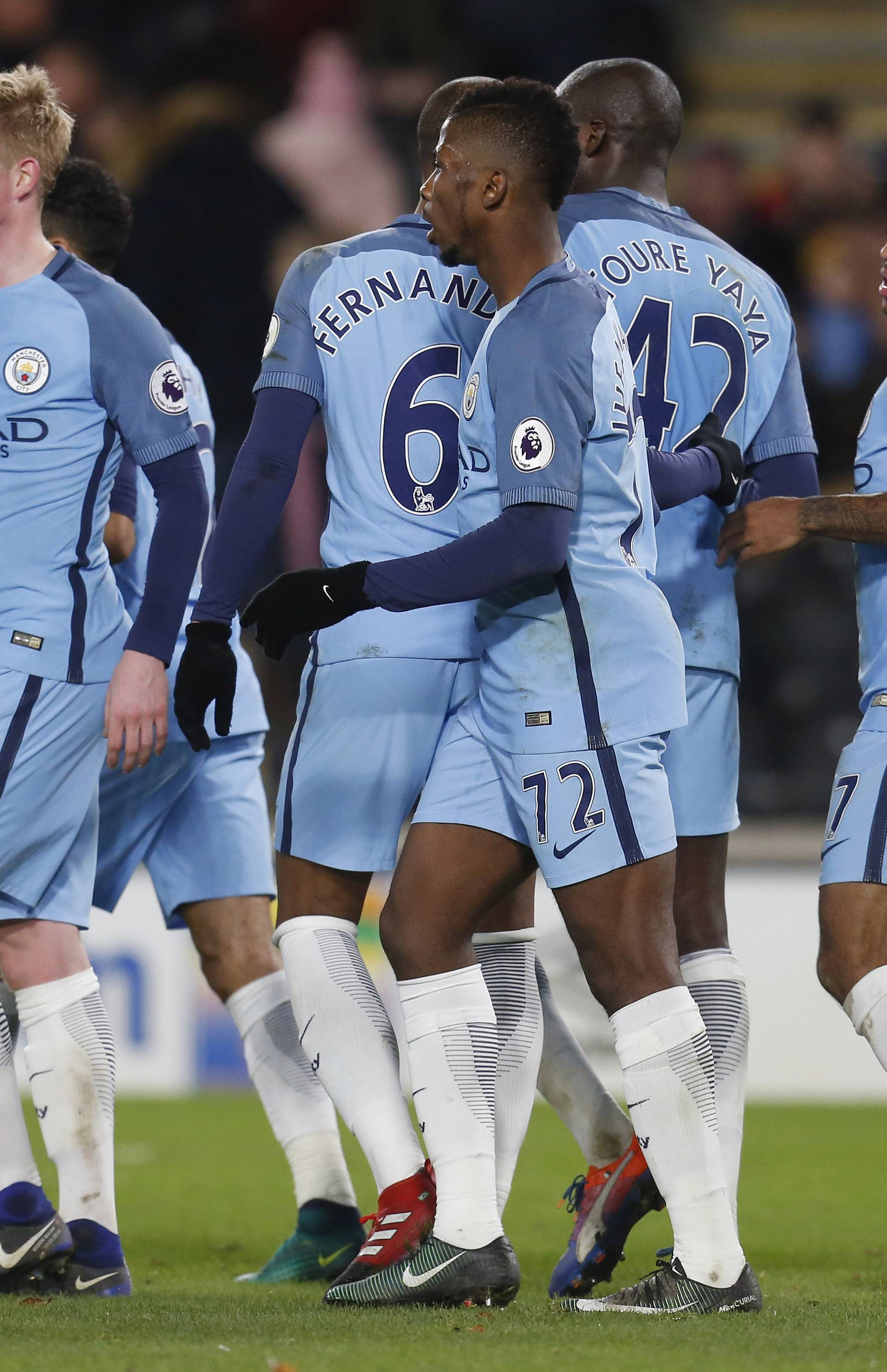 Manchester City's Raheem Sterling celebrate with team mates after Hull City's Curtis Davies scored an own goal and their third goal