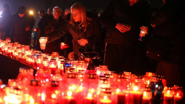 Bosnian Croats pray and light candles for the convicted general Slobodan Praljak, who killed himself seconds after the verdict in the U.N. war crimes tribunal in The Hague, in Mostar
