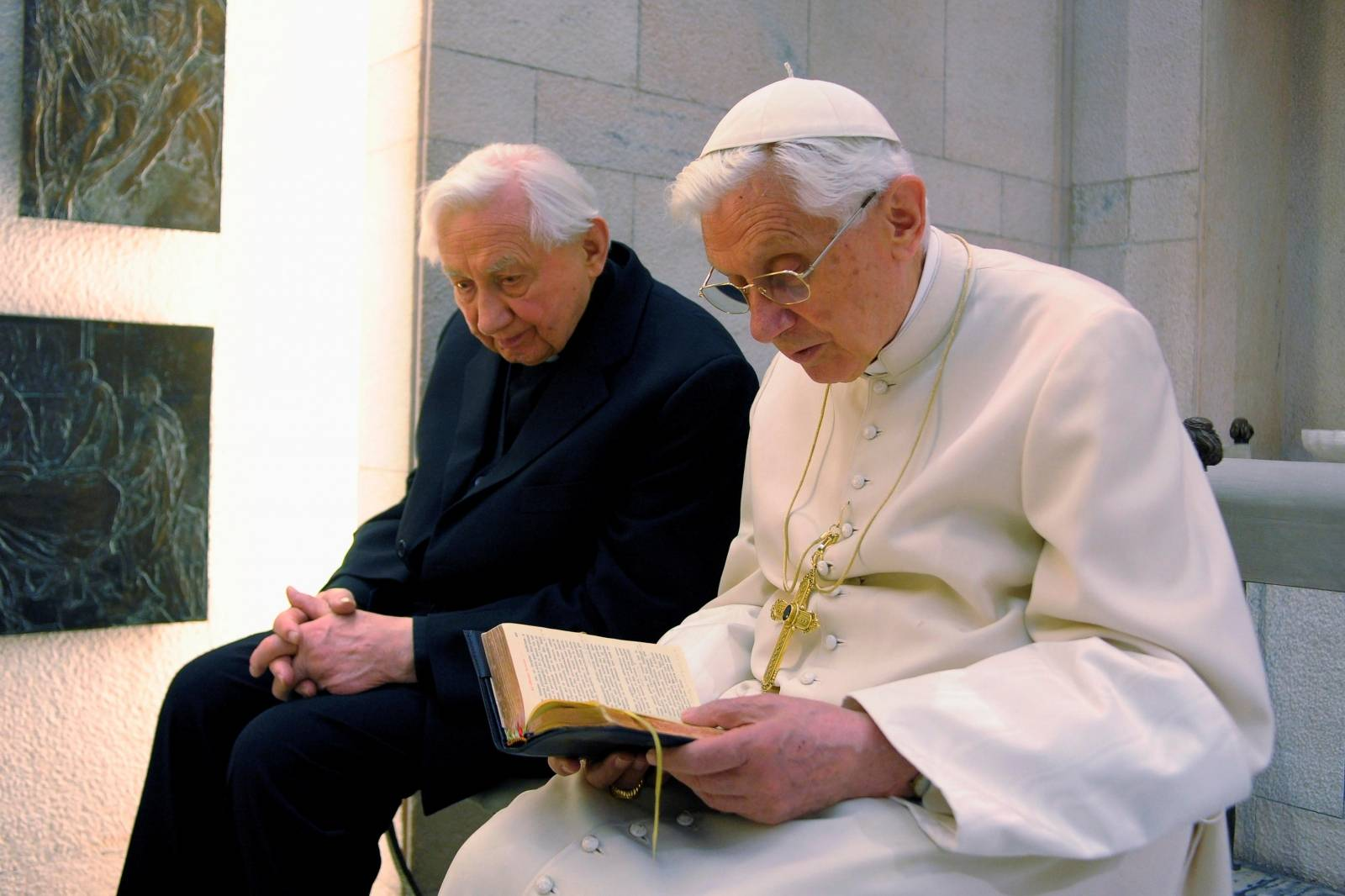 FILE PHOTO: Pope Benedict XVI prays with his brother Mons. Georg Ratzinger in his private chapel at the Vatican