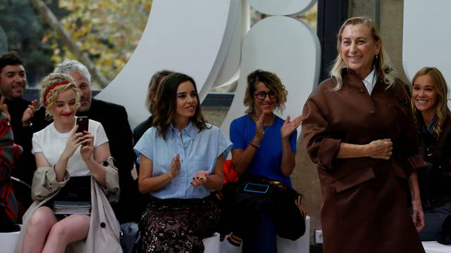 FILE PHOTO: Italian designer Miuccia Prada appears at the end of her Spring/Summer 2019 women's ready-to-wear collection show for fashion house Miu Miu during Paris Fashion Week
