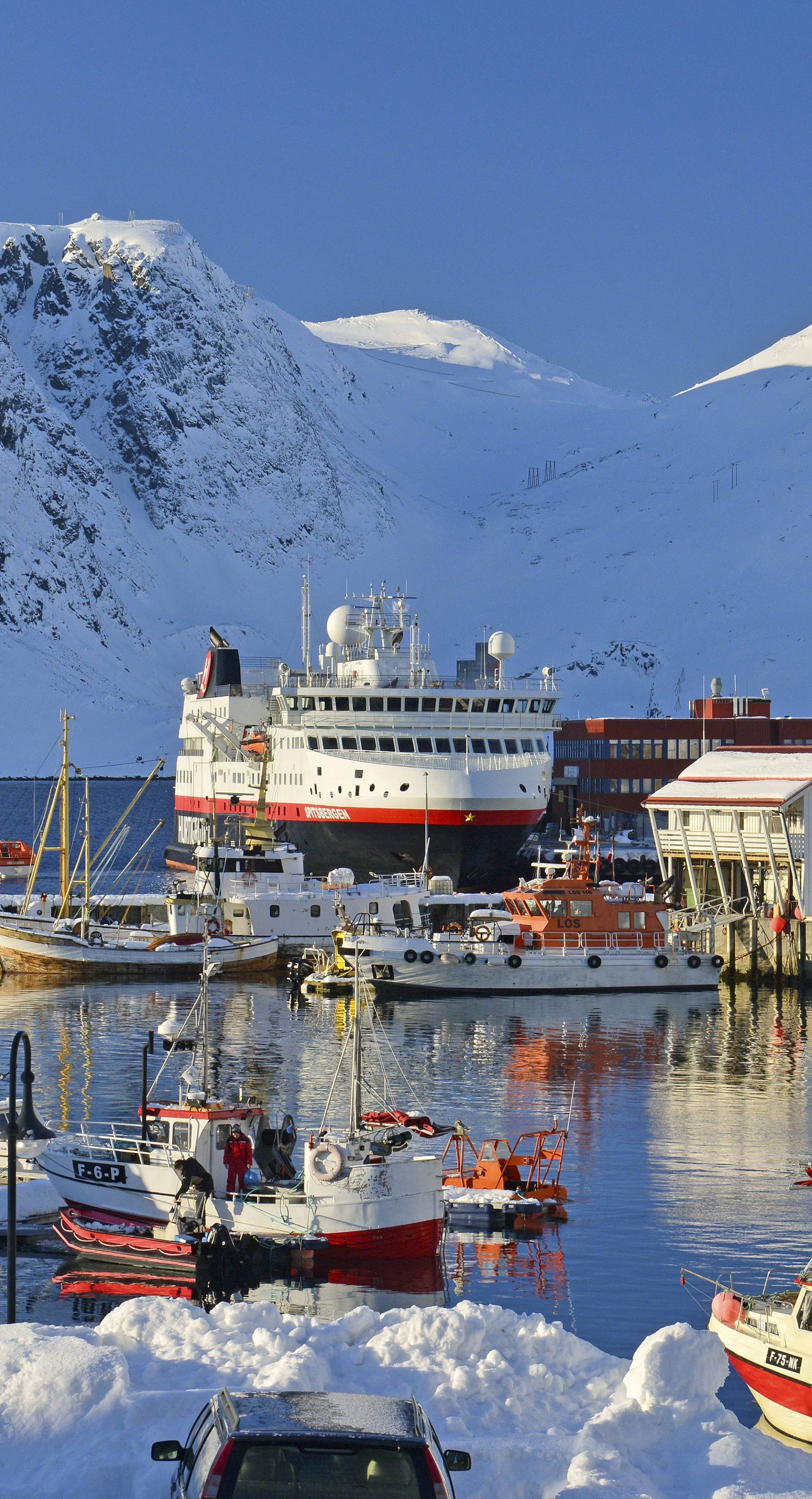 Harbour surrounded by snowcapped mountains, Norway