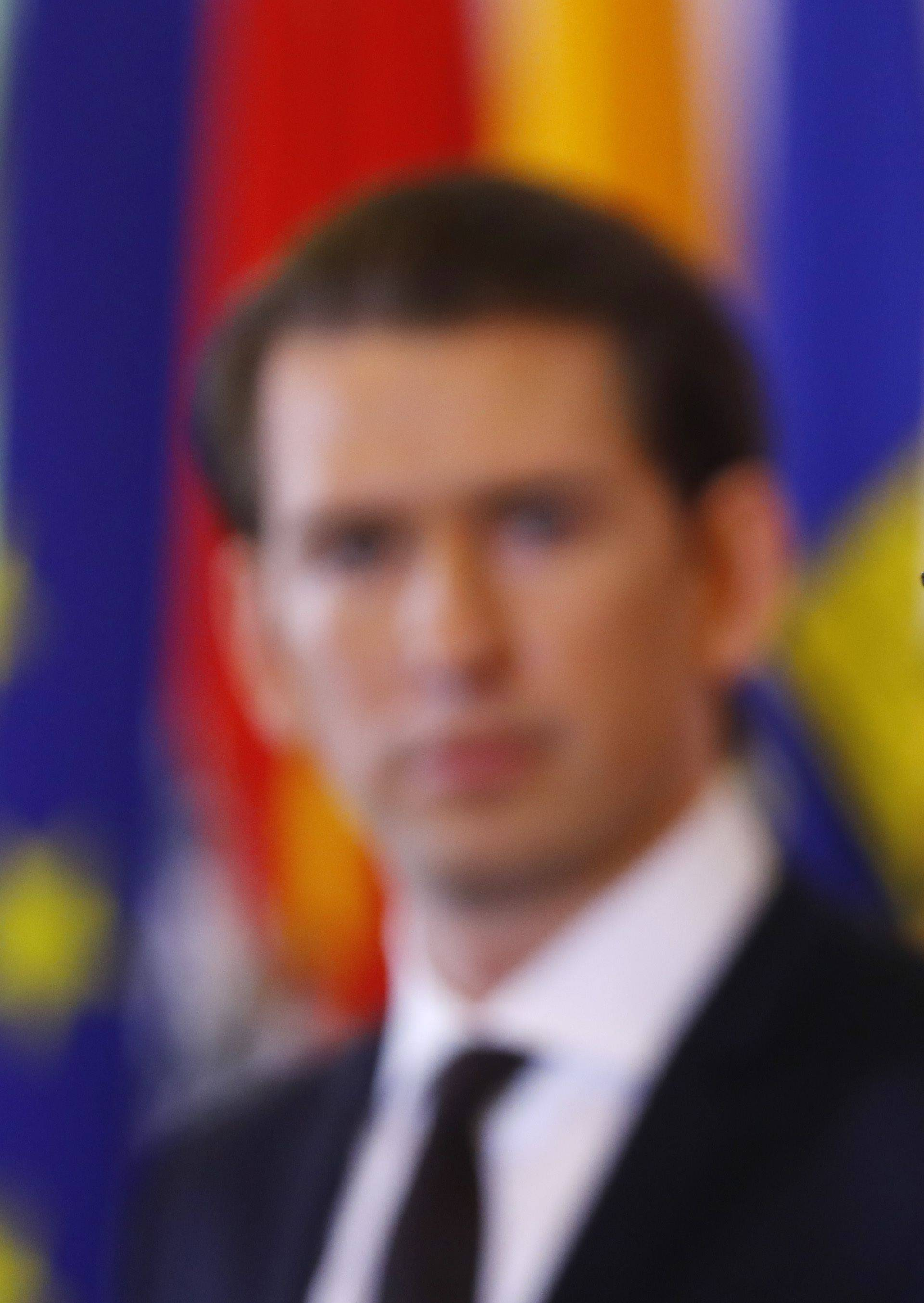 Austria's Chancellor Kurz and Vice Chancellor Strache address a news conference after a cabinet meeting in Vienna