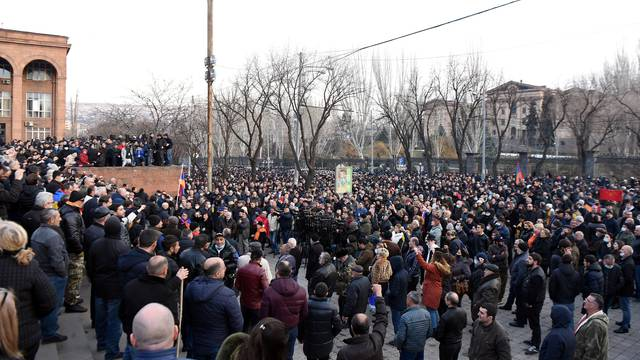 People attend an opposition rally in Yerevan