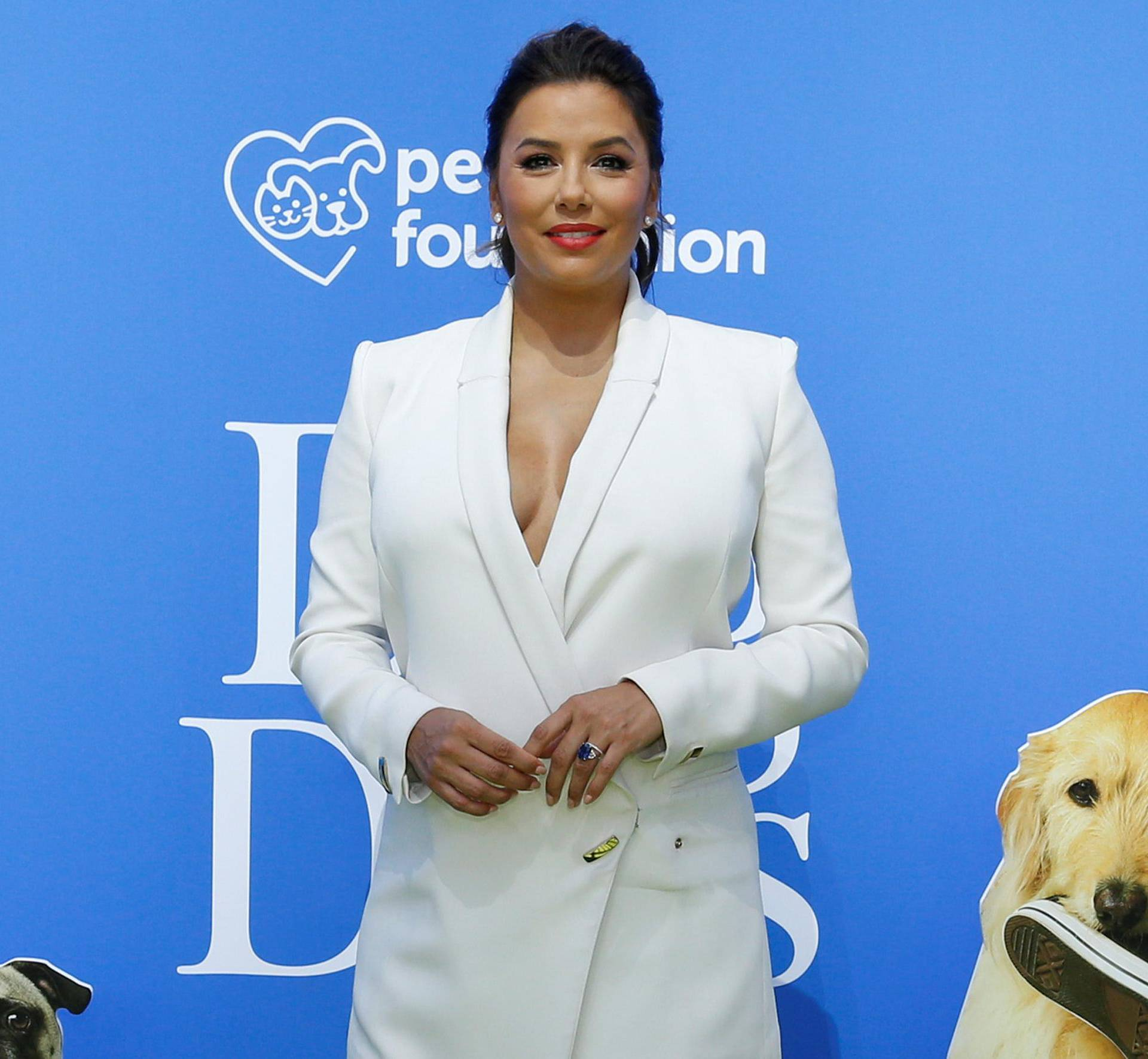 """Cast member Longoria poses at the premiere for the movie """"Dog Days"""" in Los Angeles"""