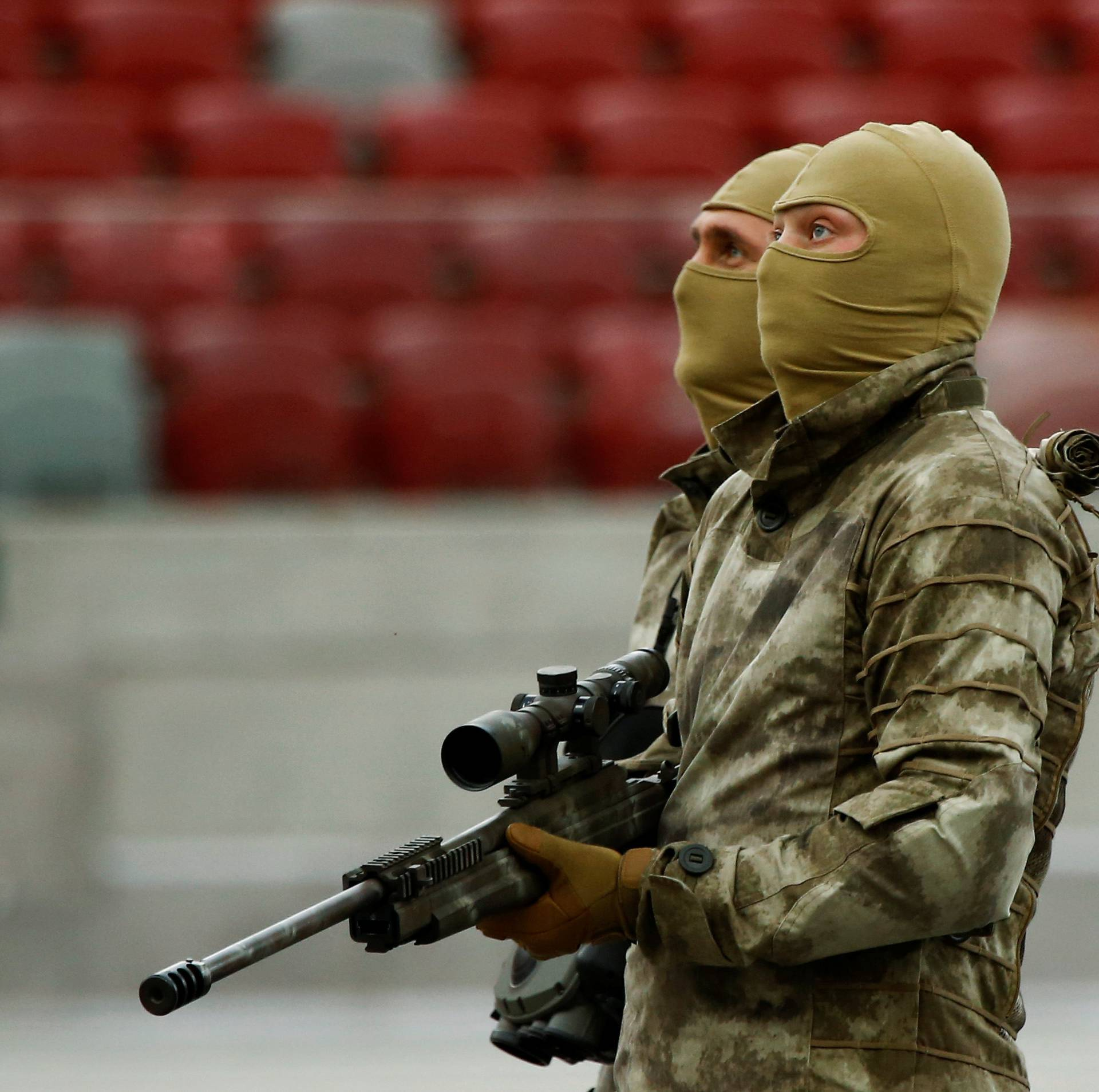 Soldiers look on after the demonstration of their skills during a military police exercise before the NATO summit in July in Warsaw, at the PGE National Stadium in Warsaw