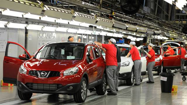FILE PHOTO: A worker is seen completing final checks on the production line at Nissan car plant in Sunderland
