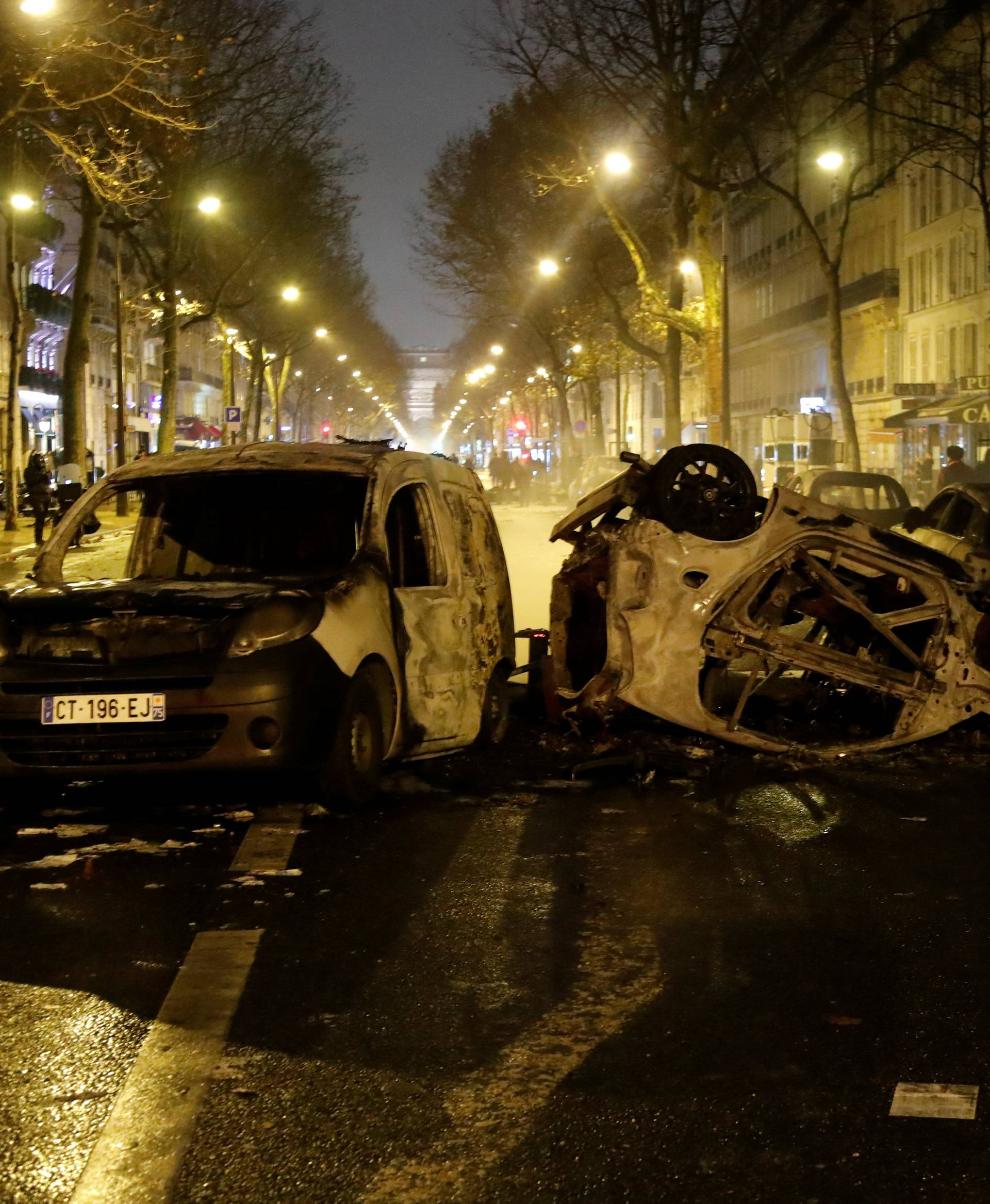 Burned cars are seen on avenue Kleber after clashes with protesters wearing yellow vests, a symbol of a French drivers' protest against higher diesel taxes, in Paris