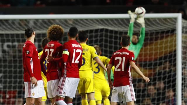 Manchester United's Sergio Romero saves a free kick from FC Rostov's Christian Noboa