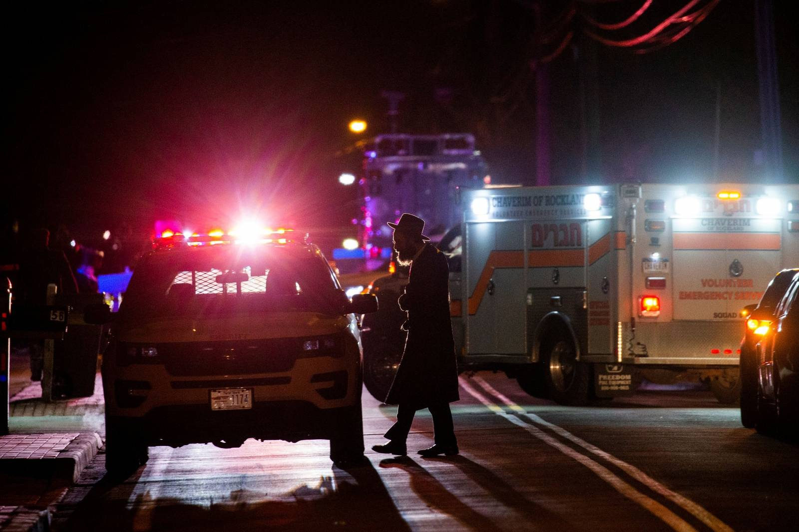 A Jewish man walks near the area where 5 people were stabbed at a Hasidic rabbi's home in Monsey, New York