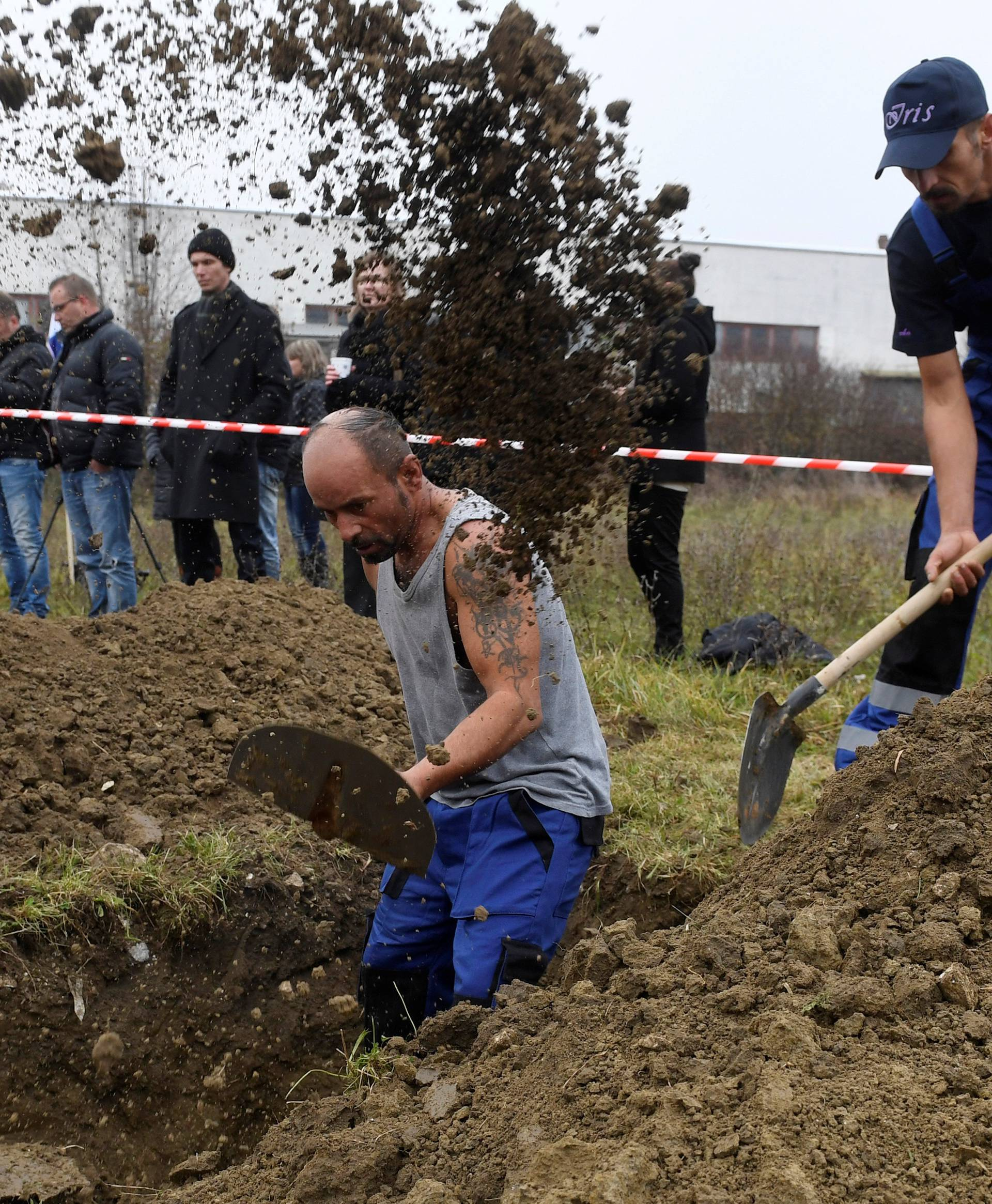 Gravediggers compete during a grave digging championship in Trencin, Slovakia