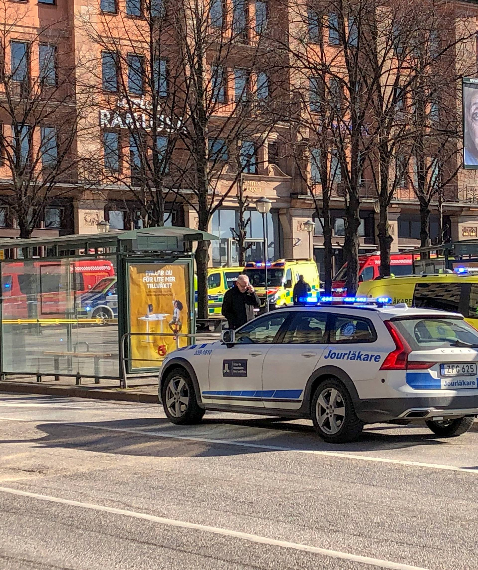 Emergency services are seen after a bus exploded and caught fire in Tegelbacken in central Stockholm