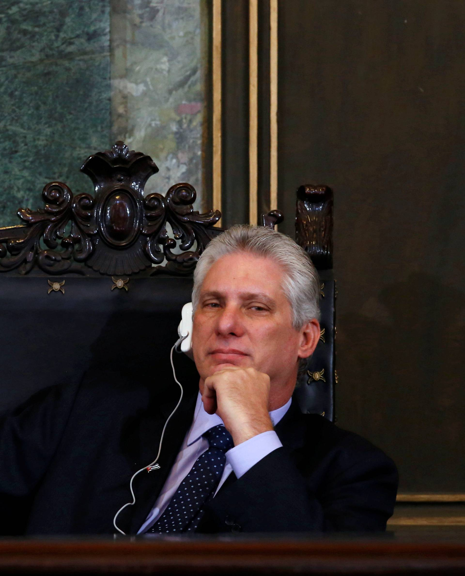 Cuba's First Vice-President Miguel Diaz-Canel listens to Vietnam's Communist Party Secretary General Nguyen Phu Trong at the University of Havana