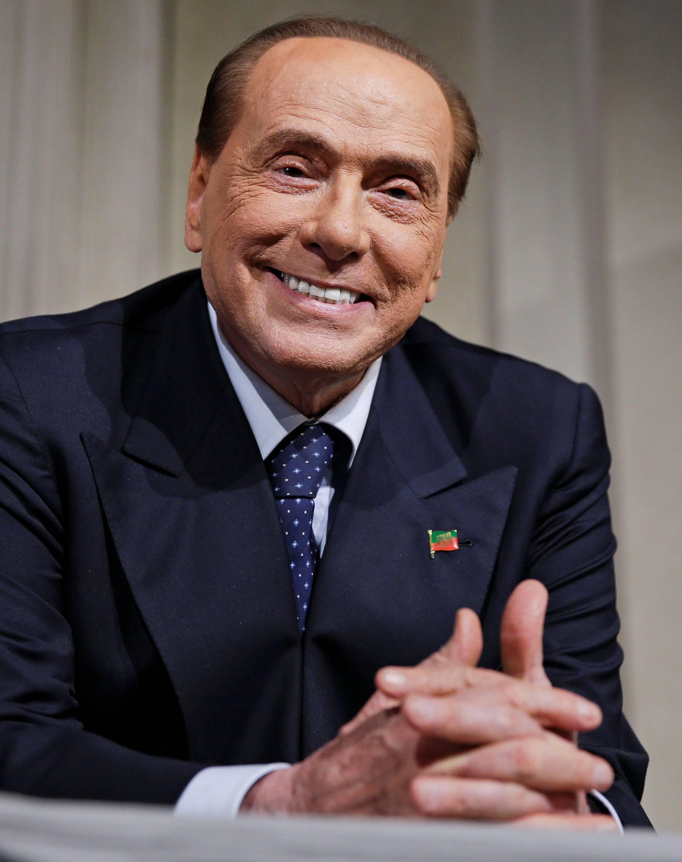 Forza Italia leader Berlusconi smiles as League party leader Salvini (not seen) speaks following a talk with Italian President Sergio Mattarella at the Quirinale palace in Rome