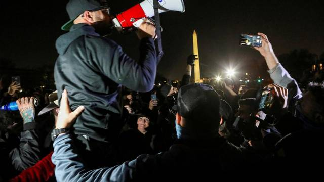 FILE PHOTO: Supporters of U.S. President Donald Trump and members of the far-right Proud Boys demonstrate, in Washington