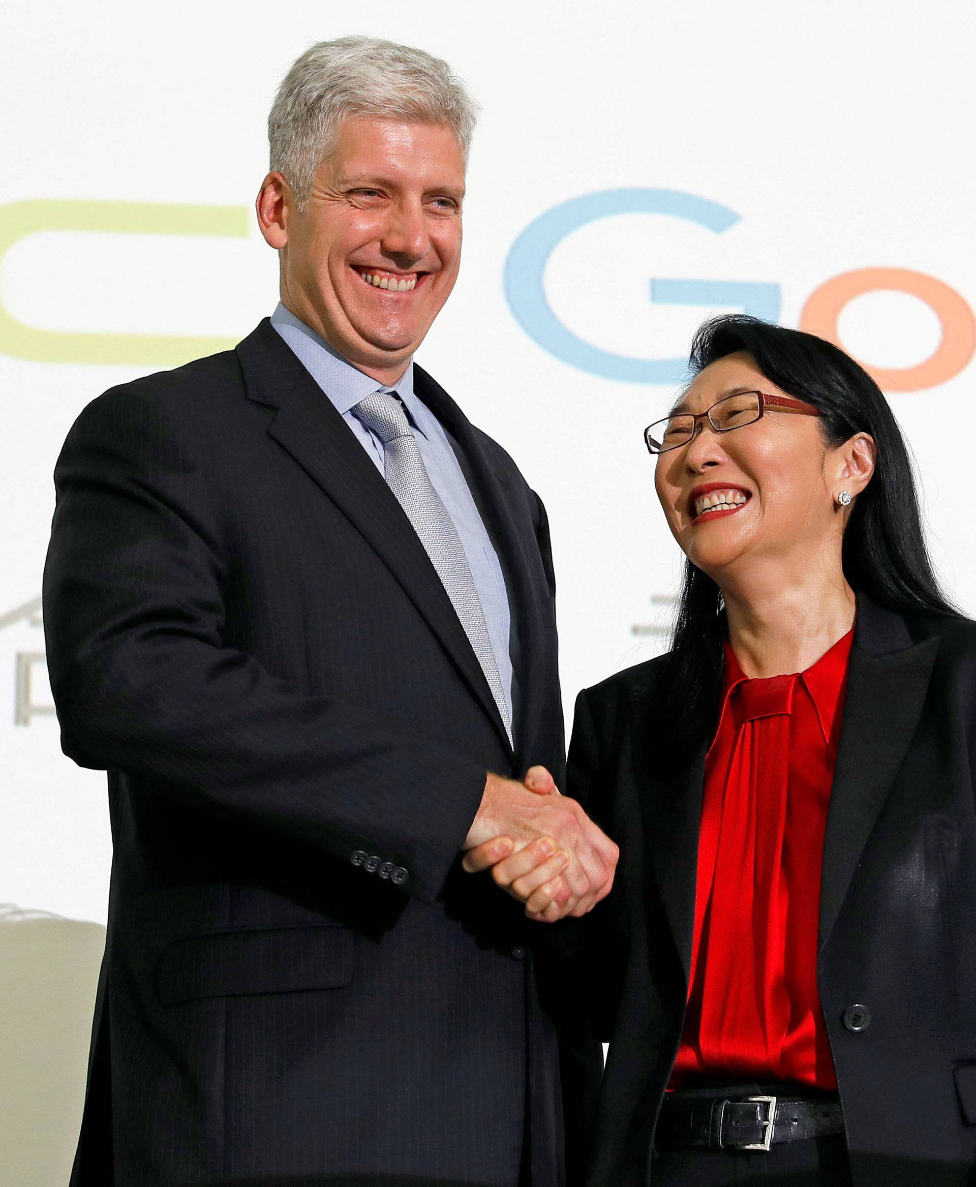 Google hardware executive Rick Osterloh shakes hand with HTC CEO Cher Wang during a news conference to announce Google to acquire HTC's Pixel smartphone division, in Taipei