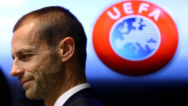 FILE PHOTO: UEFA president Aleksander Ceferin arrives at a news conference in Stara Pazova, Serbia