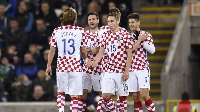 Croatia's Andrej Kramaric celebrates scoring their third goal with teammates