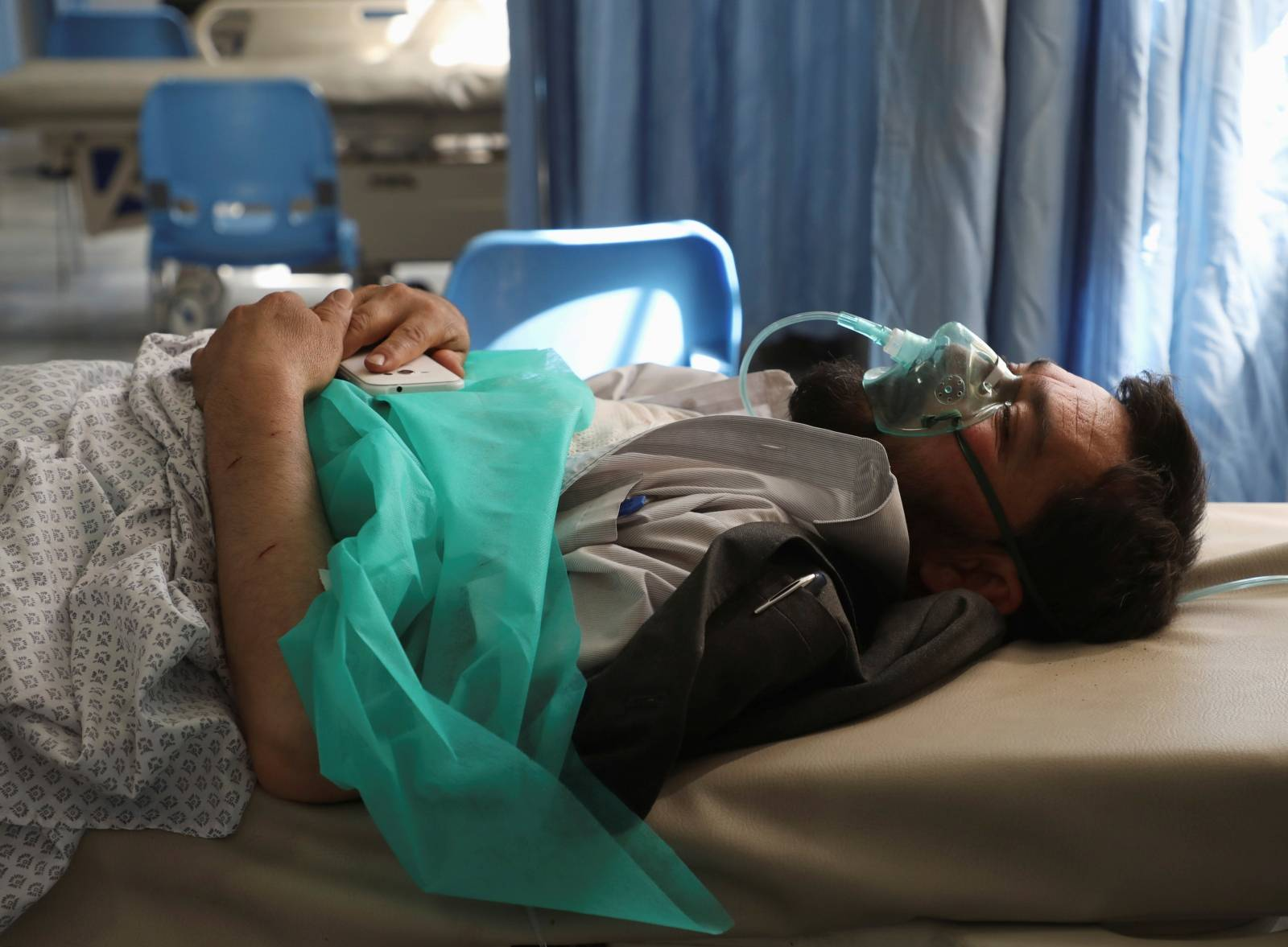 A wounded man receives treatment at a hospital after a blast in Kabul, Afghanistan
