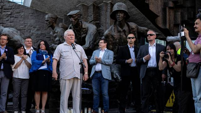 Former Polish President Lech Walesa speaks during a protest against the conservative government's makeover of the Polish judiciary in Warsaw