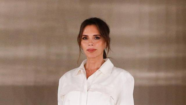 Designer Victoria Beckham at the end of her catwalk show during London Fashion Week in London