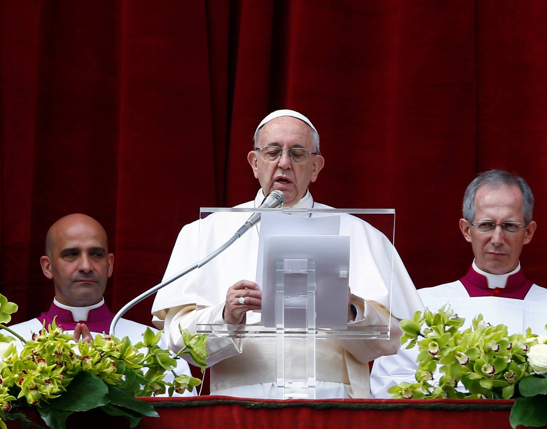 Pope Francis delivers his Easter message in the Urbi et Orbi (to the city and the world) address from the balcony overlooking St. Peter's Square at the Vatican
