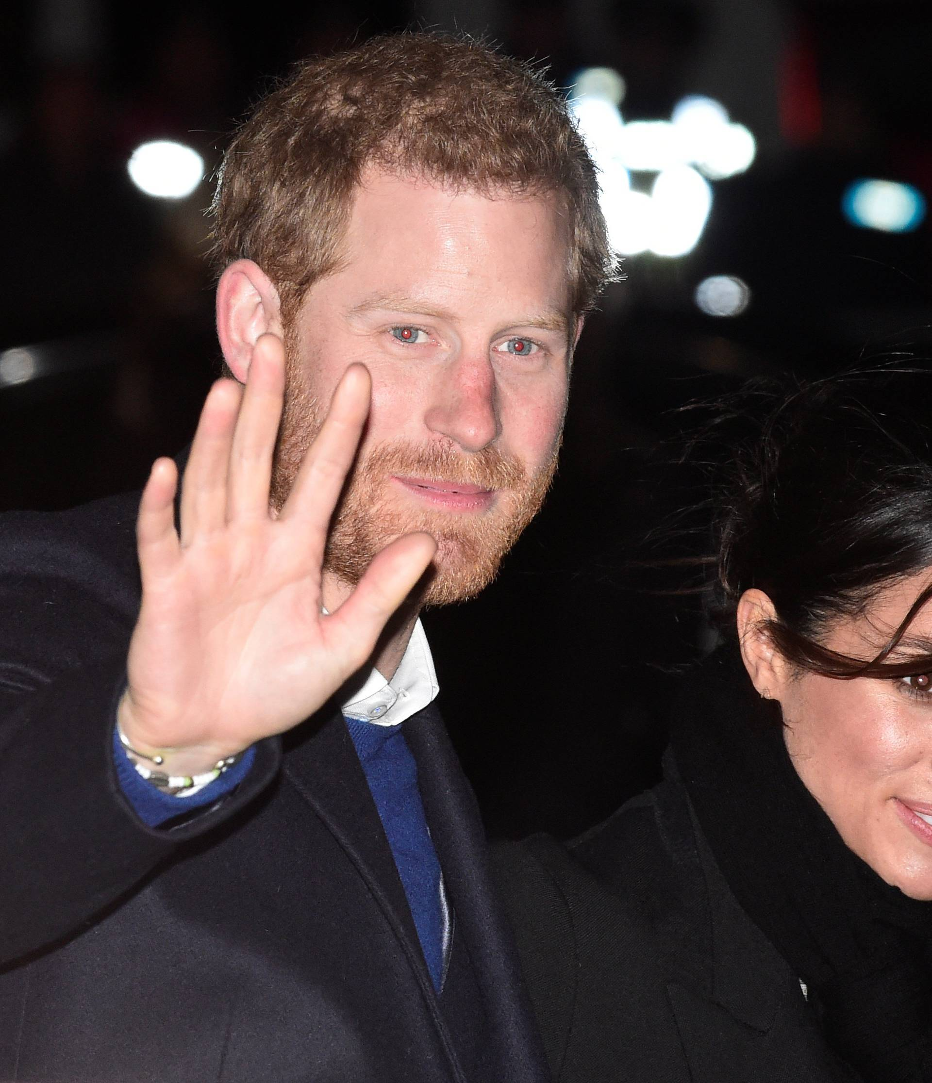 Britain's Prince Harry and his fiancee Meghan Markle leave Star Hub, a community and leisure centre, in Cardiff