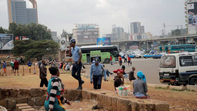 Police walk amongst civilians at the Meskel Square in Addis Ababa