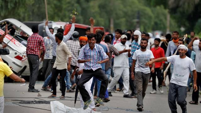 Protestors react during violence in Panchkula