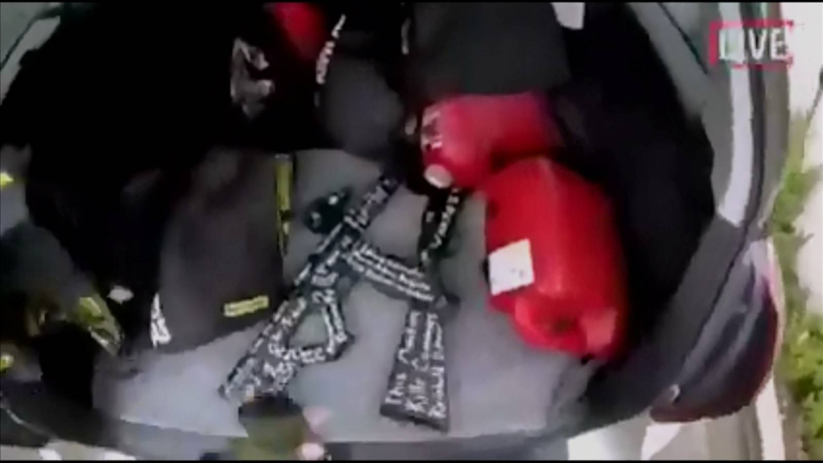 A still image taken from video circulated on social media, apparently taken by a gunman and posted online live as the attack unfolded, shows him retrieving weapons from the boot of his car in Christchurch