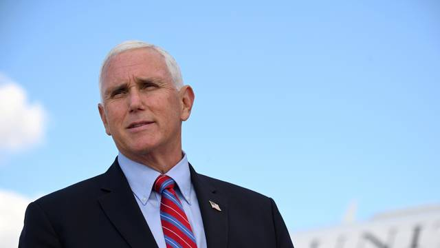FILE PHOTO: FILE PHOTO: U.S. Vice President Mike Pence departs for travel to the vice presidential debate in Salt Lake City, Utah, at Joint Base Andrews, Maryland