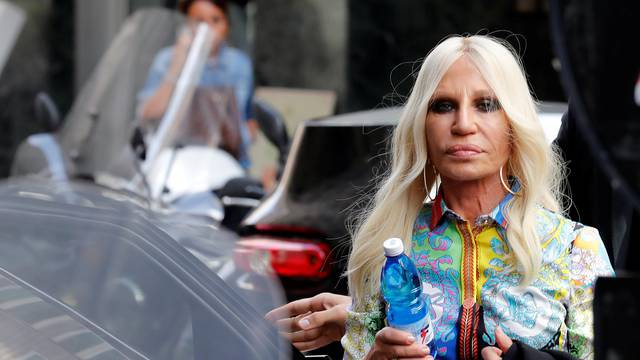 Italian designer Donatella Versace arrives to meet employees in Milan