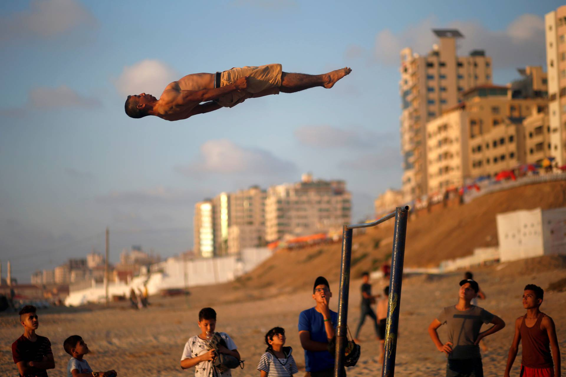Palestinians demonstrate their parkour and street workout skills as COVID-19 restrictions ease in Gaza City