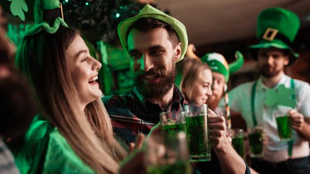 The company of young people celebrate St. Patrick's Day.