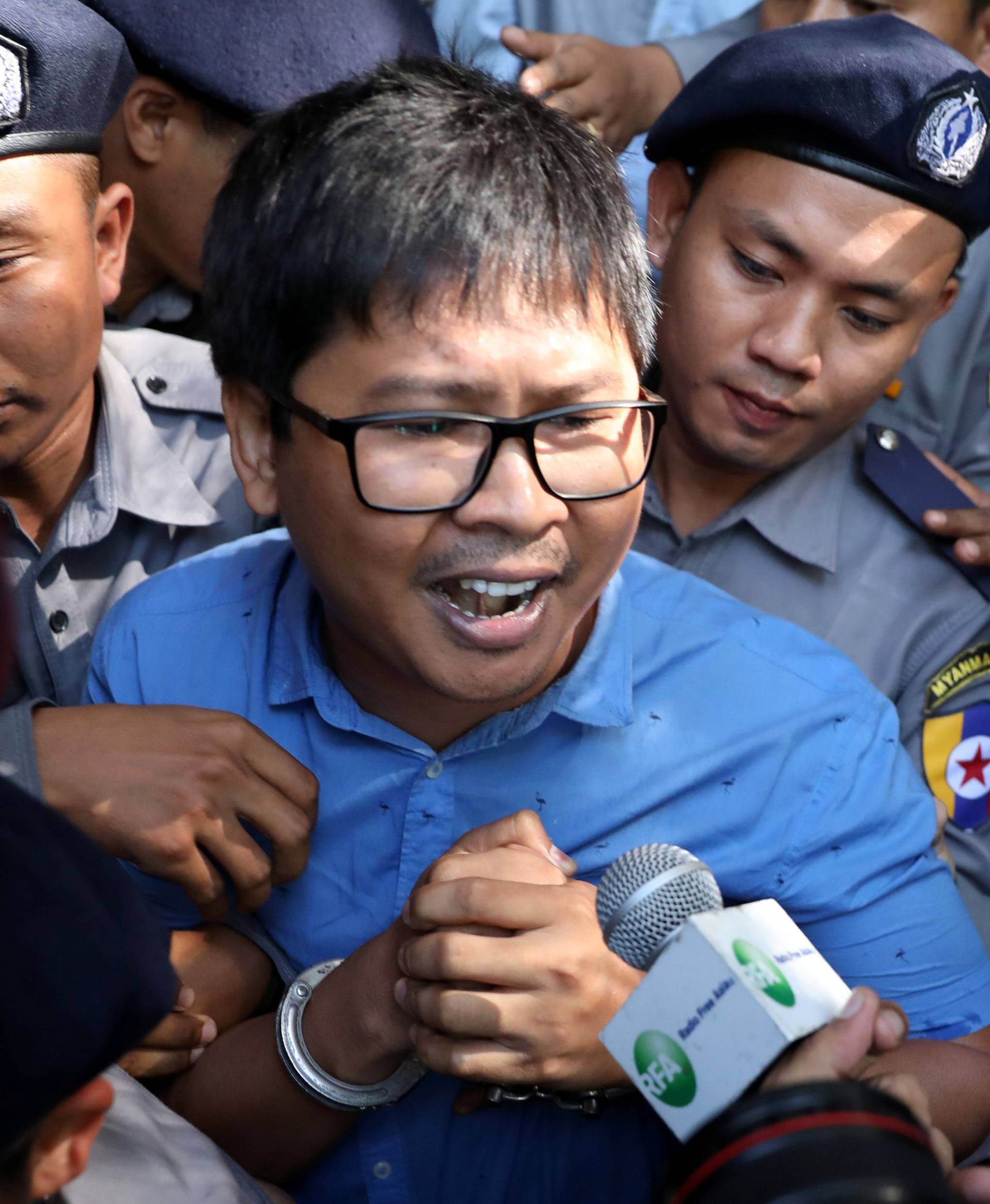 Reuters journalist Wa Lone arrives at the court in Yangon, Myanmar