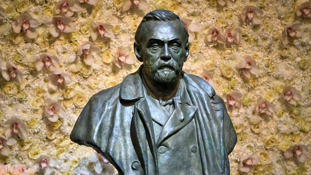 FILE PHOTO: A bronze bust of Alfred Nobel is pictured before the Nobel Prize ceremony at Stockholm Concert Hall, in Stockholm