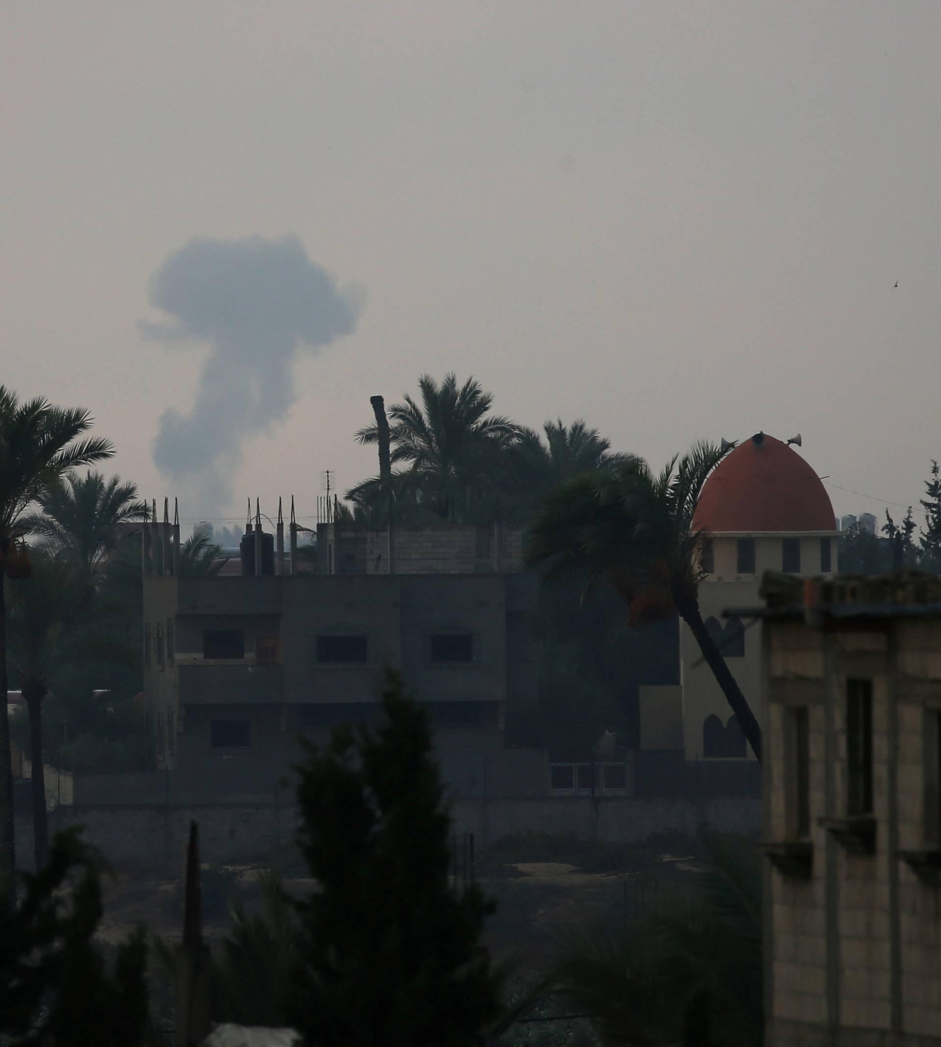 Smoke rises following an Israeli air strike in the southern Gaza Strip