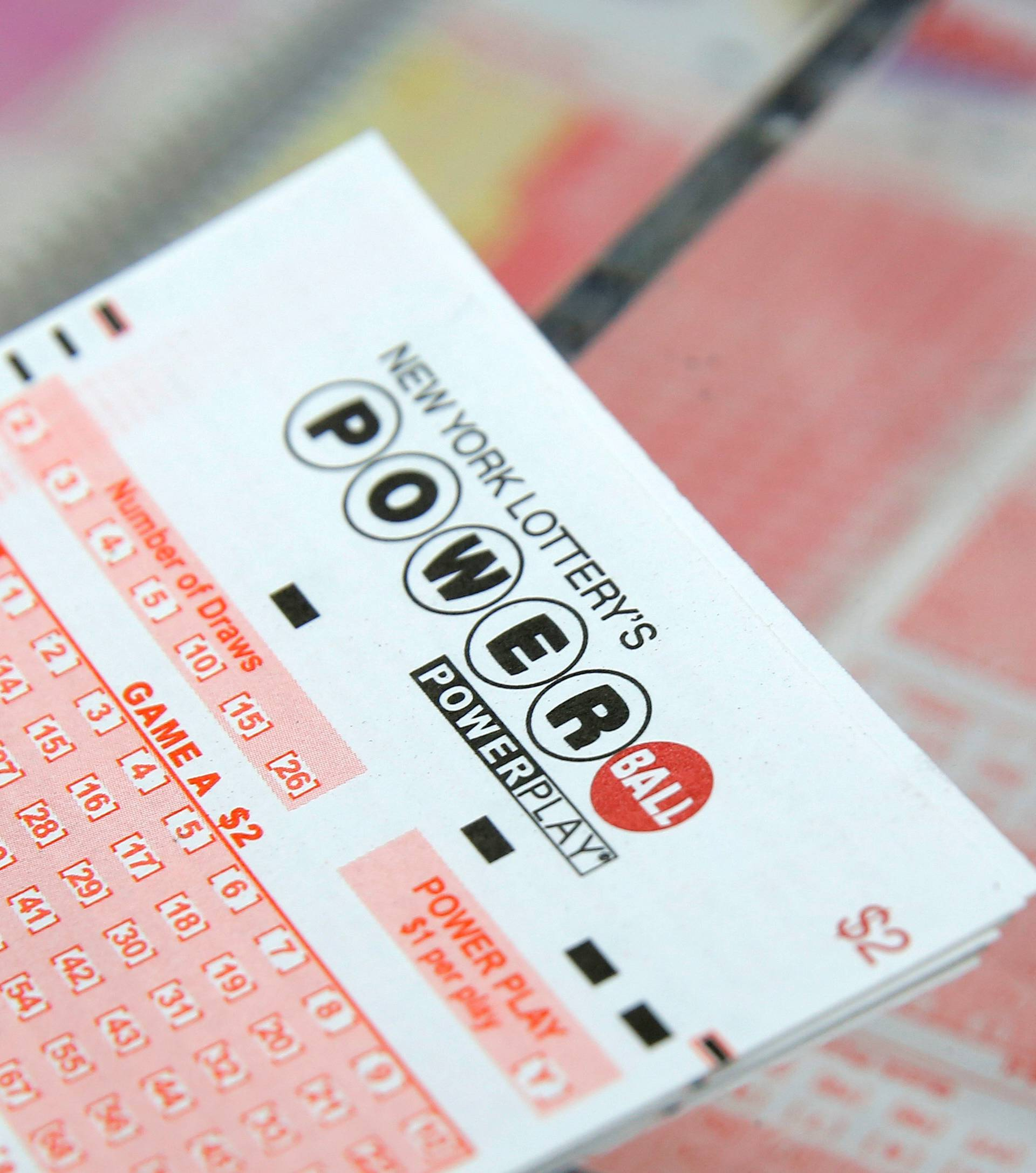 FILE PHOTO: A ticket for the U.S. lottery Powerball sits on a counter in a store on Kenmare Street in Manhattan, New York